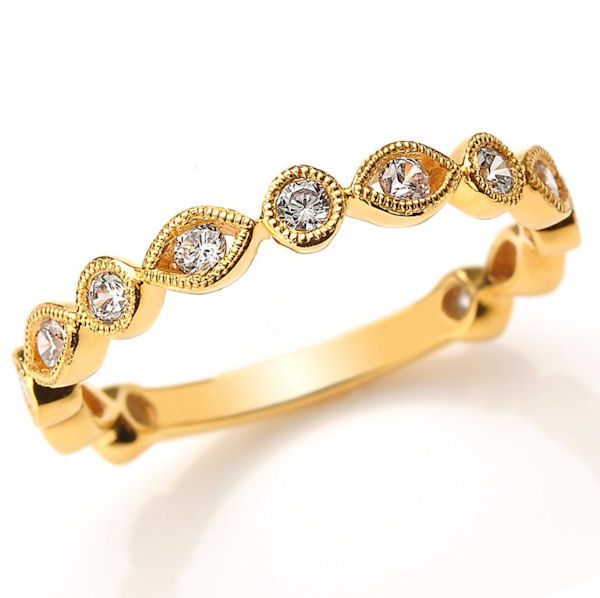 Item # M31888 - 14kt yellow gold diamond anniversary and stackable ring. There are about 13 round brilliant cut diamonds set in the ring. The diamonds are about 0.40 ct tw, VS1-2 in clarity and G-H in color.