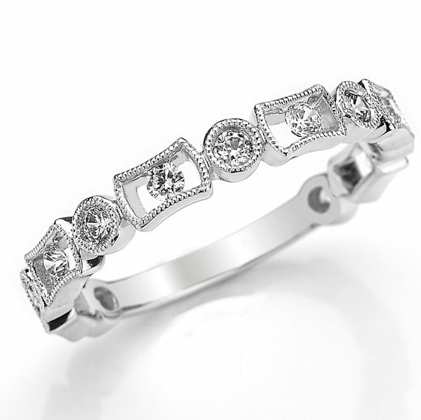Item # M31889W - 14kt white gold diamond anniversary and stackable ring. There are 13 round brilliant cut diamonds set in the ring with milgrian designs around the diamonds. The diamonds are about 0.40 ct tw, VS1-2 in clarity and G-H in color.