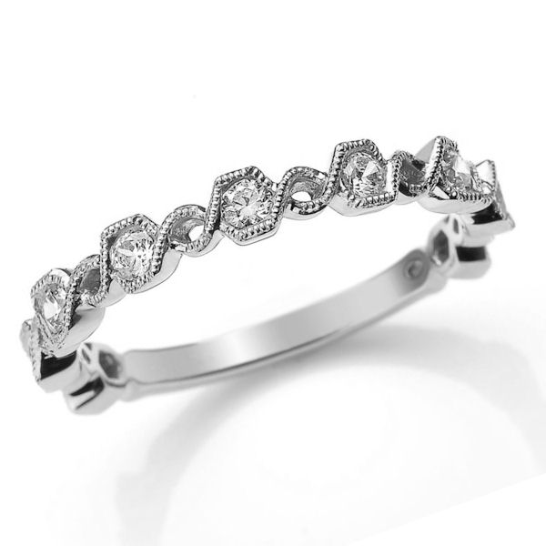 Item # M31890W - 14kt white gold diamond anniversary and stackable ring. There are about 9 round brilliant cut diamonds set in the ring with milgrain design around the ring. The diamonds are about 0.36 ct tw, VS1-2 in clarity and G-H in color.