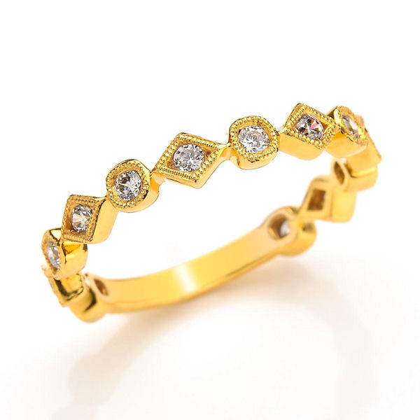 Item # M31891E - 18kt yellow gold diamond anniversary and stackable ring. There are 13 round brilliant cut diamonds set in the ring. The diamonds are about 0.35 ct tw, VS1-2 in clarity and G-H in color.