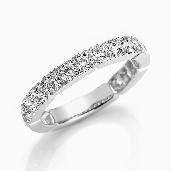 Item # M31898WE - 18kt white gold diamond anniversary and stackable ring. There are about 18 round brilliant cut diamonds set in the ring with milgrain edges. The diamonds are about 1.18 ct tw, VS1-2 in clarity and G-H in color.