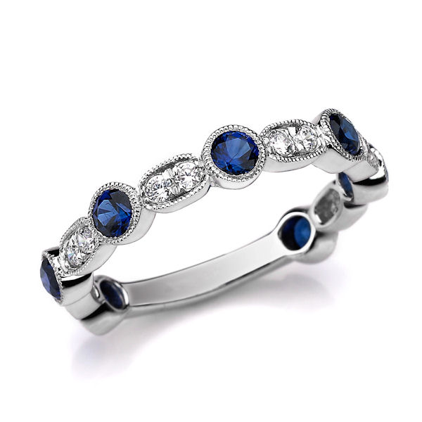 Item # M31900WE - 18kt white gold diamond and sapphire stackable ring. There are about 19 round brilliant cut diamonds and sapphires. The diamonds are about 0.21 ct tw, VS1-2 in clarity, G-H in color and the genuine blue sapphires are about 0.87 ct tw.