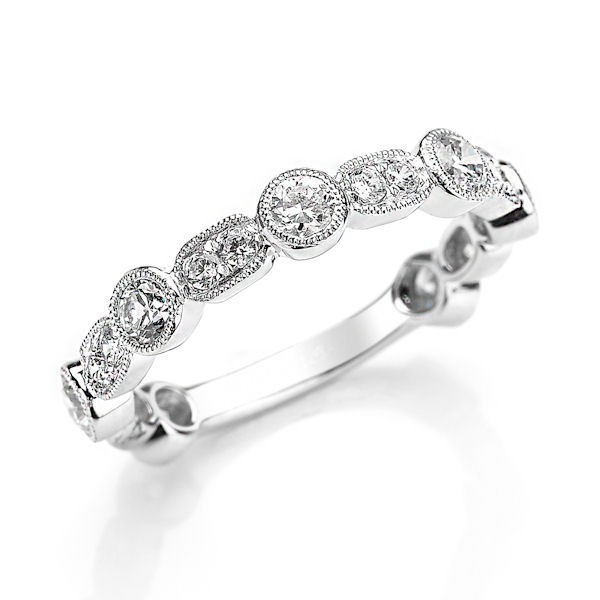 Item # M31901W - 14kt white gold diamond anniversary and stackable ring. There are about 19 round brilliant cut diamonds set in the ring with milgrain edges around the diamonds. The diamonds are about 0.88 ct tw, VS1-2 in clarity and G-H in color.