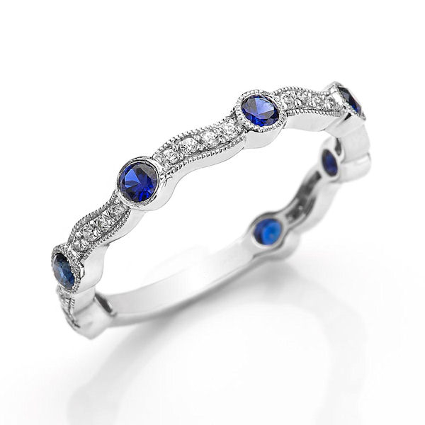 Item # M31902WE - 18kt white gold diamond & sapphire anniversary and stackable ring. There are about 31 round brilliant cut diamonds and genuine blue sapphires. The diamonds are about 0.12 ct tw, VS1-2 in clarity, G-H in color and 0.37 ct tw genuine blue sapphires.