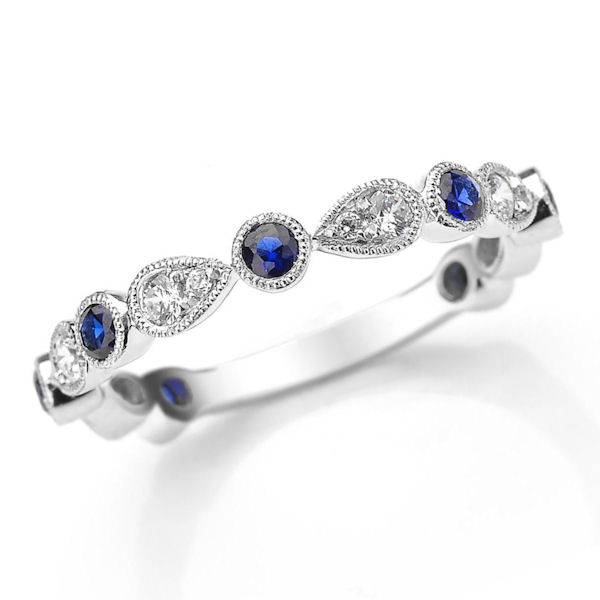 Item # M31904W - 14kt white gold diamond and sapphire stackable and anniversary ring. There are 13 round brilliant cut diamonds and sapphires set in the ring with milgrain designs around the stones. The diamonds are about 0.25 ct tw, VS1-2 in clarity, G-H in color and the genuine blue sapphires are about 0.40 carats.