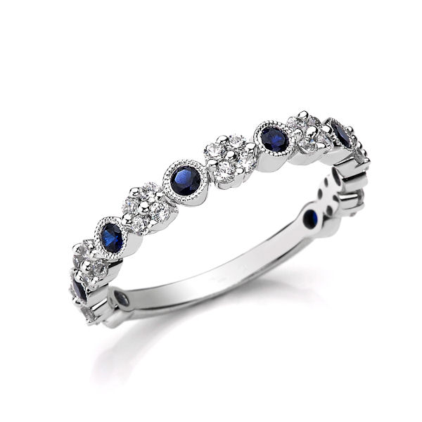 Item # M31954W - 14kt white gold diamond & sapphire anniversary ring with milgrain design.  There are about 36 round brilliant cut diamonds and genuine blue sapphires set in the ring. The diamonds are about 0.30 ct tw, VS1-2 in clarity, G-H in color and about 0.37 ct tw genuine blue sapphires.