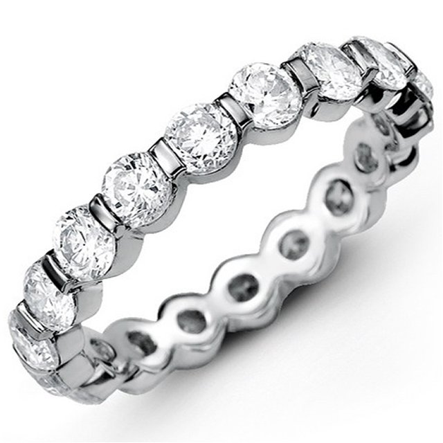 Item # MS20039WE - 18K white gold diamond eternity bend. The band bar set holds 14 round brilliant cut diamonds with total weigh of 5.0ct in size 6.0. The diamonds are graded as VS in Clarity G-H in Color.