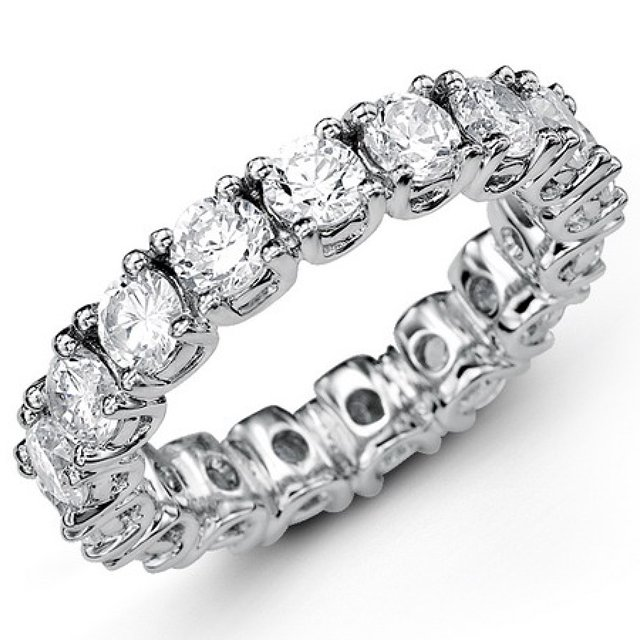 Item # MS20043WE - 18K white gold diamond eternity band. The band set in prongs  holds 16 round brilliant cut diamonds with total weigh of 4.0ct in size 6.0. The diamonds are graded as VS in Clarity G-H in Color.