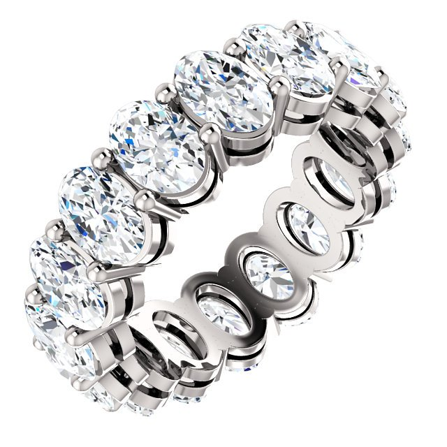 Item # SO128658PP - Platinum diamond eternity band. The band in size 6.0 holds 16 matching oval shape brilliant diamonds each measuring 6.0X4.0mm. The diamonds together weigh approximately 8.0ct in size 6.0. The diamonds are graded as VS1 in clarity G in color.