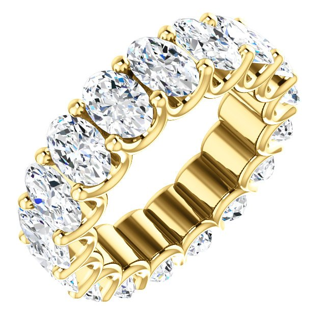 Item # SO128869700E - 18K gold diamond eternity band made with all matching oval shape diamonds. In size 6.0 Diamonds approximate total weight is 7.0ct. Diamonds are graded as VS in clarity G in color..