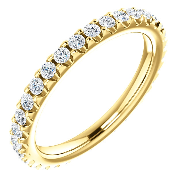 Item # SR127714050E - 18K gold diamond eternity band. The ring in size 6.0 holds approximately 33 round brilliant cut diamonds with total weight of  0.50ct. The diamonds are graded as VS in clarity G-H in color.