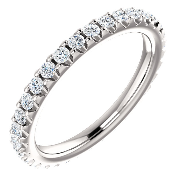 Item # SR127714050WE - 18K white gold diamond eternity band. The ring in size 6.0 holds approximately 33 round brilliant cut diamonds with total weight of  0.50ct. The diamonds are graded as VS in clarity G-H in color.