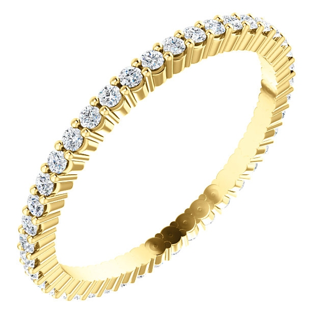Item # SR127785038E - 18K yellow gold eternity band. The band in size 6.0 holds 40 round brilliant cut diamonds with total weight of approximately 0.38ct. The diamonds are graded as VS in clarity G-H in color.