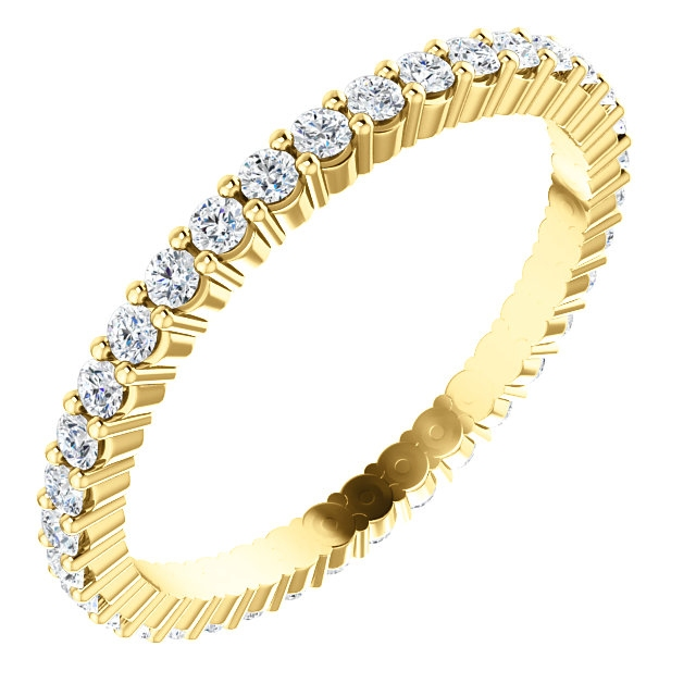 Item # SR127785050 - 14K yellow gold eternity band. The band in size 6.0 holds 36 round brilliant cut diamonds with total weight of approximately 0.50ct. The diamonds are graded as VS in clarity G-H in color.
