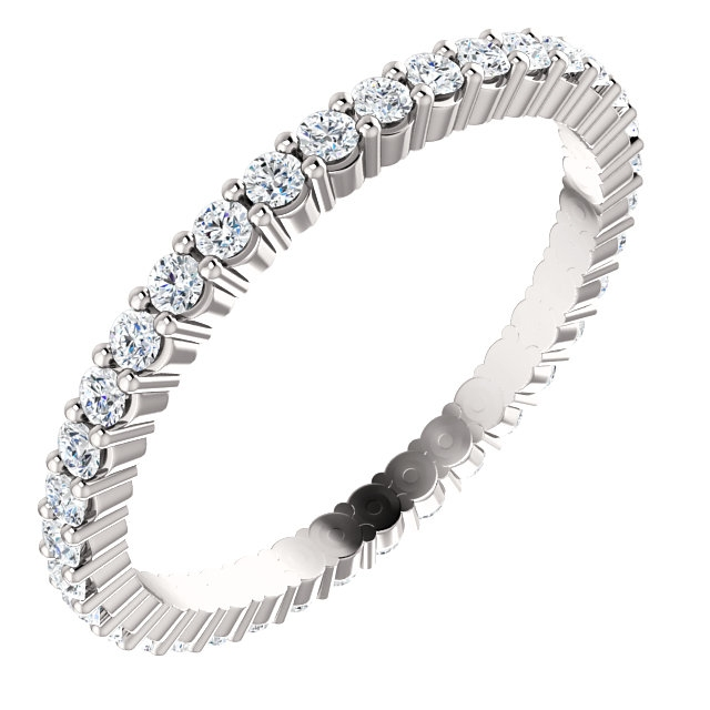 Item # SR127785050WE - 18K white gold eternity band. The band in size 6.0 holds 36 round brilliant cut diamonds with total weight of approximately 0.50ct. The diamonds are graded as VS in clarity G-H in color.