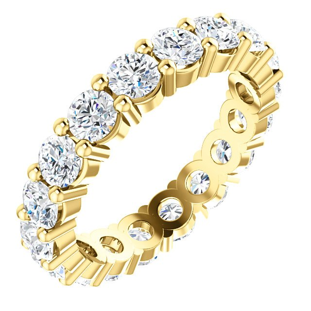 Item # SR127785E - Round brilliant diamond eternity band in 18K gold. The band holds 16 Diamonds each measures 3.75mm in diameter. The diamonds together weigh approximately 3.2ct in size 6.0. The diamonds are all matching and are graded as VS2 in clarity G-H in color.