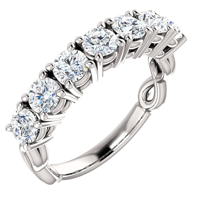 Item # SR128541W - 14K white gold 7 diamonds anniversary ring with infinity symbol on the sides. Diamonds together weigh approximately 1.50ct. The diamonds are graded as G-H in color and VS in clarity.