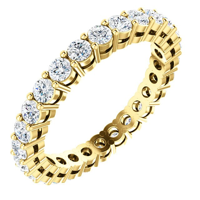 Item # SR128658100E - 18K yellow gold diamond eternity band. The ring in size 6.0 holds approximately 26 round brilliant cut diamonds with total weight of  1.0ct. The diamonds are graded as VS in clarity G-H in color.