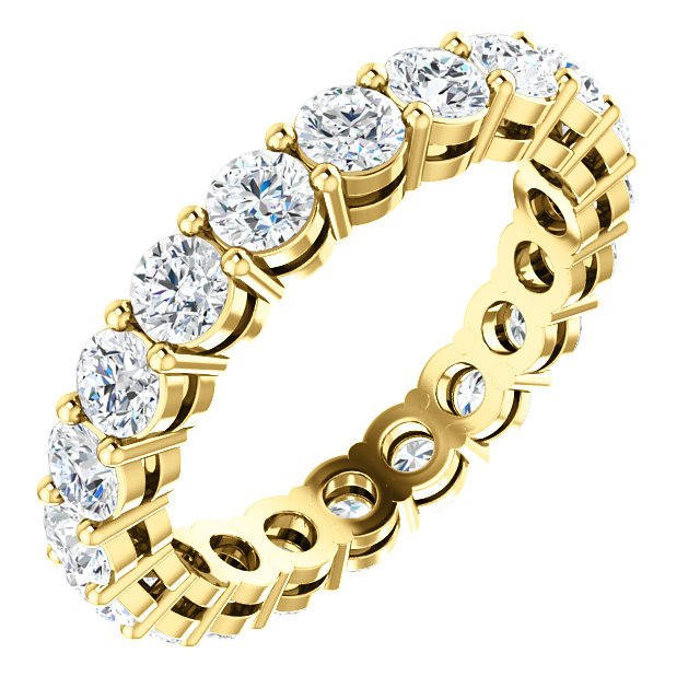 Item # SR128658200 - 14K yellow gold eternity band. The band holds 20 round brilliant cut diamonds each measuring 3.0mm and together they weigh approximately 2.0ct.  in size 6.0. The diamonds are graded as VS in clarity G-H in color.
