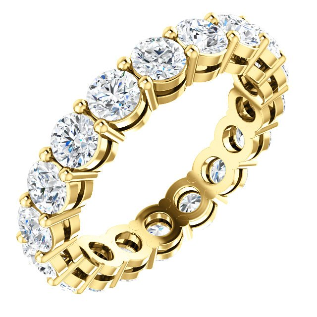 Item # SR128658275E - 18K yellow gold eternity band. The band holds 18 round brilliant cut diamonds each measuring 3.4mm and together they weigh approximately 2.75ct. insize 6.0. The diamonds are graded as VS in clarity G-H in color.