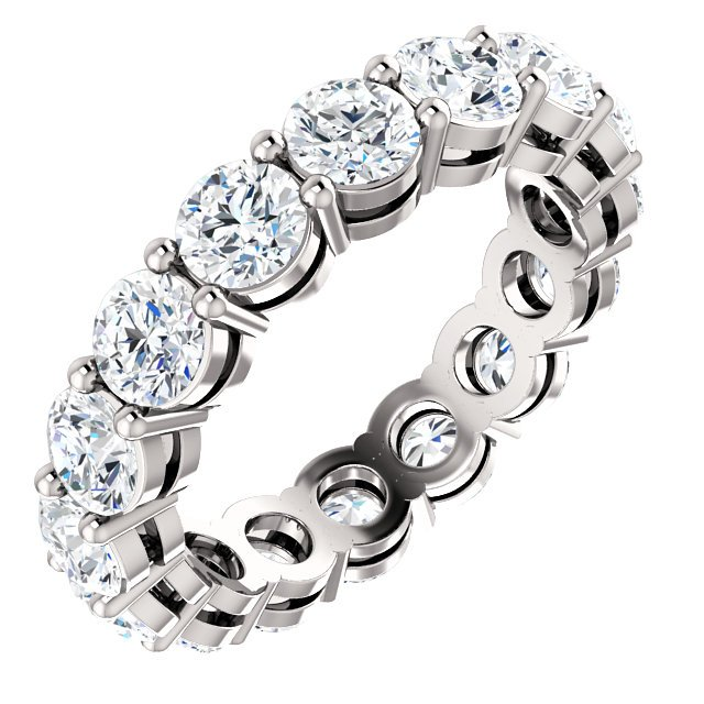 Item # SR128658275WE - 18K white gold eternity band. The band holds 18 round brilliant cut diamonds each measuring 3.4mm and together they weigh approximately 2.75ct. insize 6.0. The diamonds are graded as VS in clarity G-H in color.