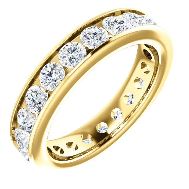 Item # SR128774210E - 18Kt yellow gold eternity ring. The ring holds 21 round brilliant cut diamonds, each measures 3.0 mm. The diamonds are approximately 2.10 ct tw, VS1-2 in clarity, very clean and G-H in color, near colorless to colorless. The diamonds are channel set. There may be more diamonds in larger ring sizes. The band is about 4.3mm wide. The finish is polished. Different finishes may be selected.