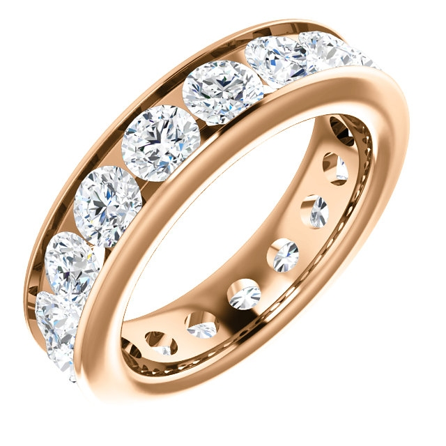 Item # SR128774350RE - 18K rose gold eternity band. The ring holds 17 round brilliant cut diamonds, each measures 3.8 mm. The diamonds total weight is approximately 3.50ct, in size 6.0. VS1-2 in clarity, very clean and G-H in color, near colorless to colorless. The diamonds are channel set. There may be more diamonds in larger ring sizes. The band is about 4.8mm wide.