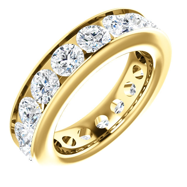 Item # SR128774450E - 18K yellow gold eternity band. The ring holds 17 round brilliant cut diamonds, each measures 4.1mm. The diamonds total weight is approximately4.50ct, in size 6.0. VS1-2 in clarity, very clean and G-H in color, near colorless to colorless. The diamonds are channel set. There may be more diamonds in larger ring sizes. The band is about 5.4mm wide.