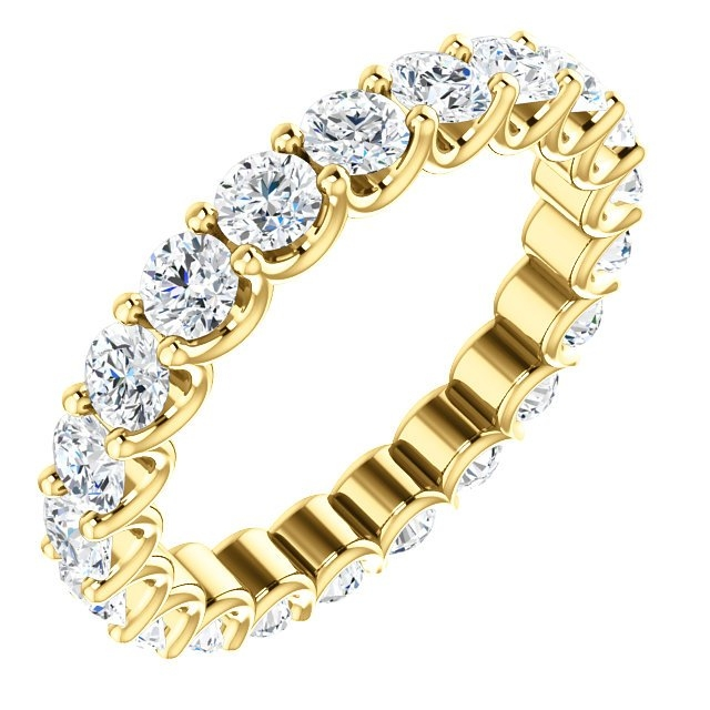 Item # SR128869210E - Eternal-Love diamond eternity band in 18K yellow gold. Diamonds are set in shared prongs with a draped side profile displays an endless row of floating round brilliant-cut diamonds. The diamond total weight is approximately 2.10ct in size 6.0.