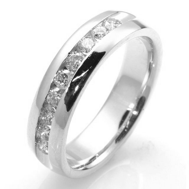Item # W7832W - Diamond wedding band. 14k white  gold 6.0mm wide 9 round brilliant cut channel set diamonds with total weight 0.54ct. The diamonds are graded as VS in clarity G-H in color. The ring is comfort fit and high polish.