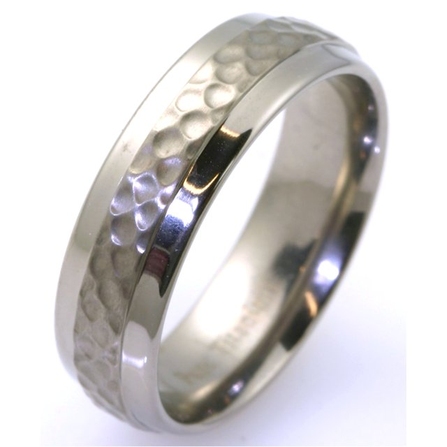 Item # WB7658TI - Titanium classic 6.5 mm wide hammered, comfort fit wedding band. The center of the ring has a brushed hammered finish and the outer edges are polished. Available between size 9 to 13 in half size increments
