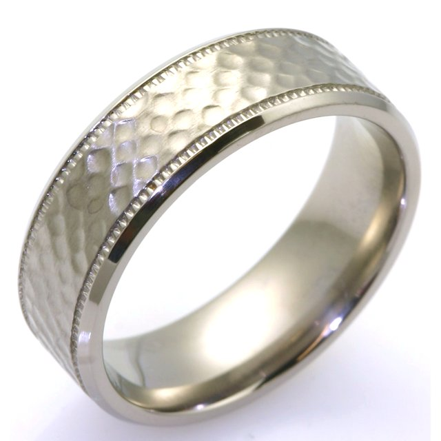 Item # WB7661TI - Titanium classic 6.5 mm wide hammered comfort fit wedding band. The center of the ring has a brushed hammered finish and the outer edges are polished. Available between size 9 to 13 in half size increments