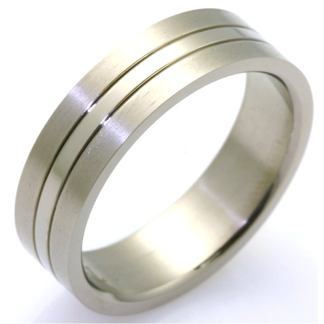Item # WB7676TI - Titanium ring with shiny stripe in the center - 6.5mm width. Available between size 9 to 13 in half size increments
