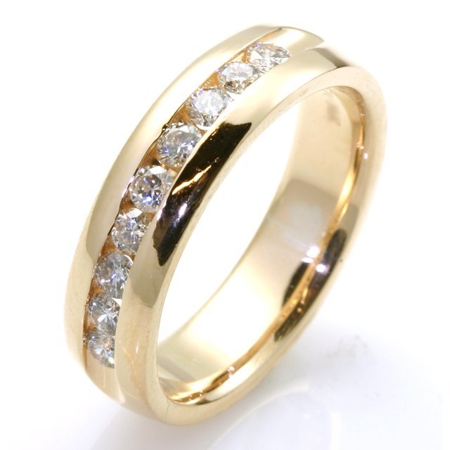 Item # WB7832E - Diamond wedding band. 18k yellow gold 6.0mm wide 9 round brilliant cut channel set diamonds with total weight 0.54ct. The diamonds are graded as VS in clarity G-H in color. The ring is comfort fit and high polish.